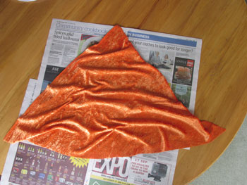 Bunch up the fabric and glue to cardboard cone.