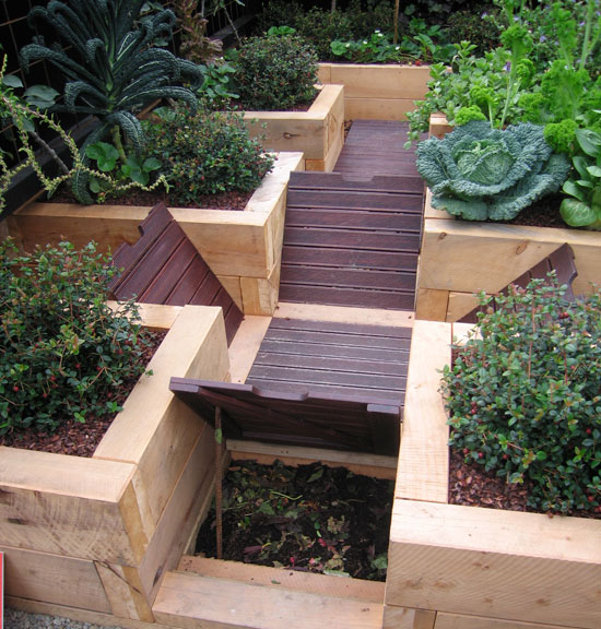 In this small courtyard garden, composting is hidden beneath the boardwalk.