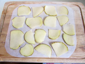 Before cooking, sandwich the slices between parchment paper. Lightly sprinkle with salt or herbs.