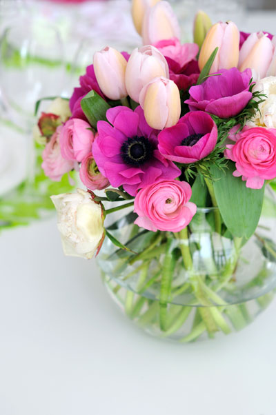 A vase full of anemones and ranunculus (my favourites) and tulips.