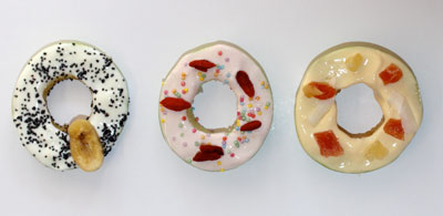Healthy apple 'doughnuts' - apple slices topped with yoghurt and sprinkles