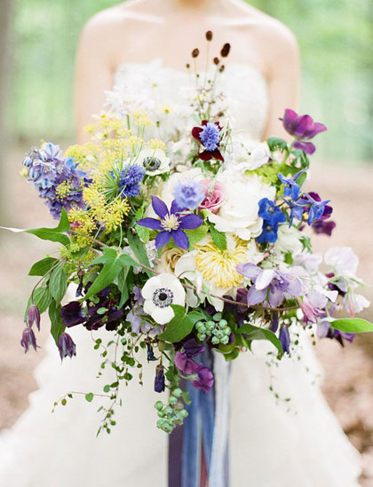 A beautiful mix of blooms, all of which can be grown in the home garden.  Image from Green Wedding Shoes.